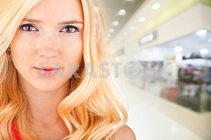 beautiful woman on the background of the shop interior