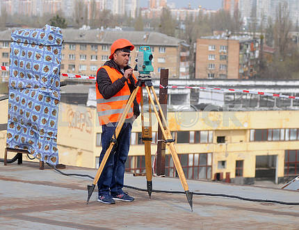Worker with a theodolite