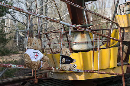 Plush toys on the carousel in the city of Pripyat