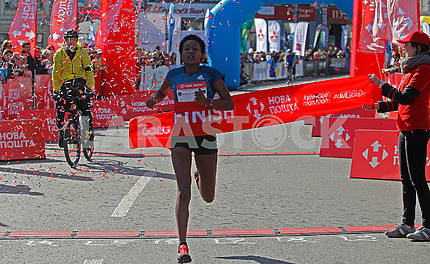 The dark-skinned runner at the finish