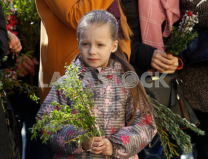 A girl with willow twigs
