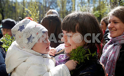 A girl in her mother's arms