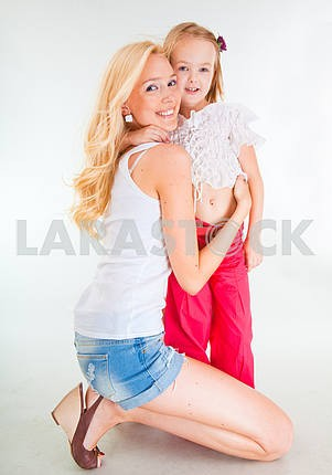 Mother and daughter hug
