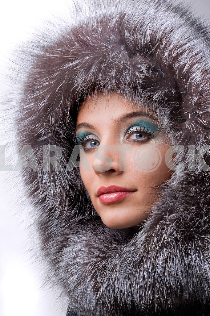 Portrait of the beautiful young woman with a fur hood — Image 5479