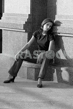 Young woman sitting on the step at home