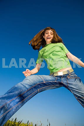 Happy young woman enjoying summer