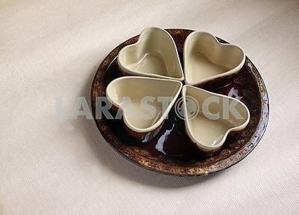 Four ceramic bowls and round ceramic plate