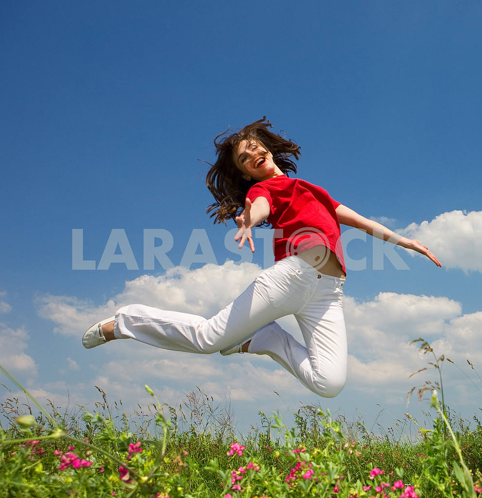 Happy young woman jumping — Image 5536