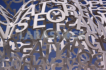 Composition with white letters on a blue sky