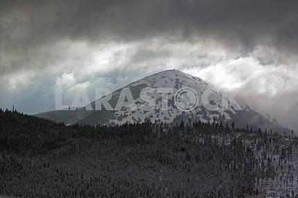 Picturesque clouds around the mountain Khomiak, 1542 m