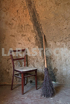 Old wooden chair and birch broom