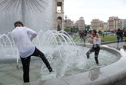 Schoolboys bathe in fountains
