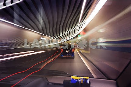 Long exposure photo of traffic with blurred traces from cars