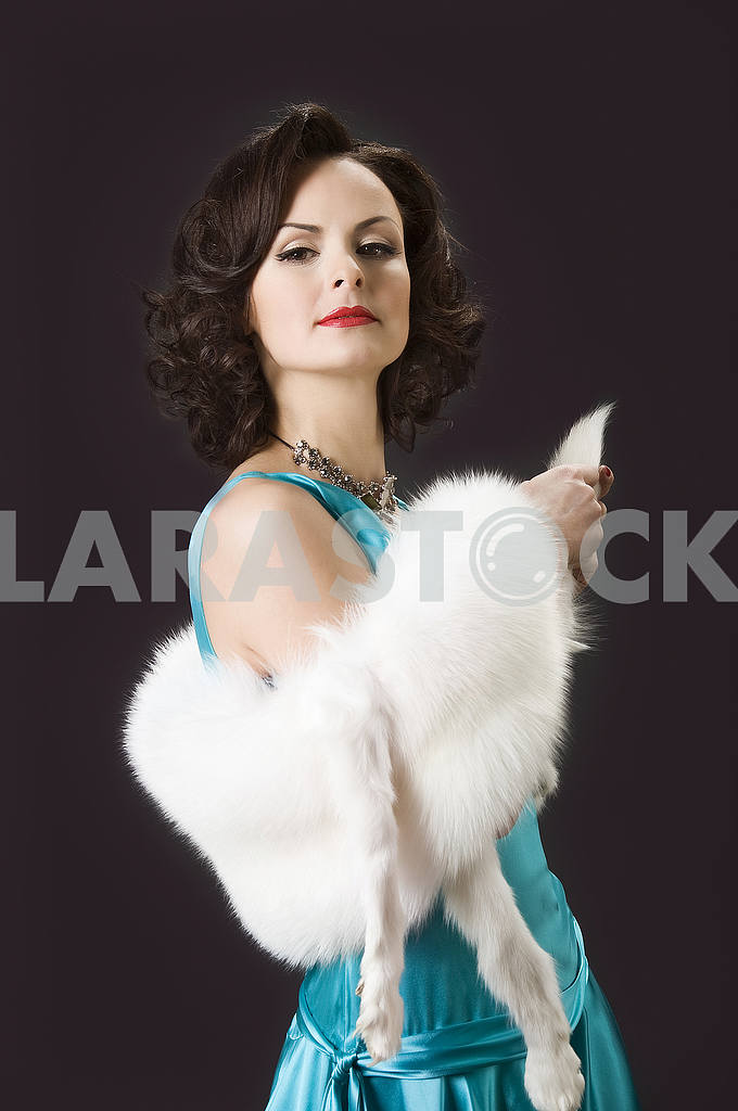 Studio picture of beautiful woman with white fur — Image 55979