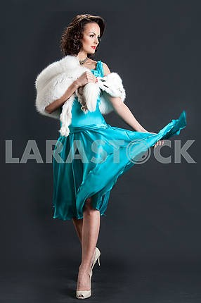 Studio picture of beautiful woman with white fur