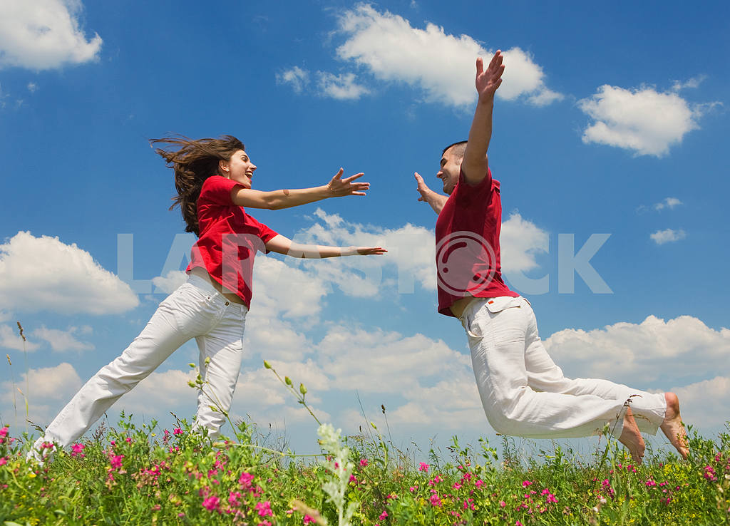 Happy Young love Couple - jumping under blue sky — Image 5610