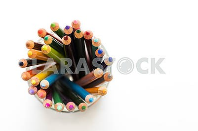 Colored pencils in an arrangement on a white background