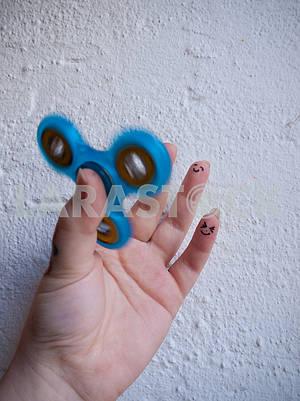 Moving Fidget Spinner in Hand