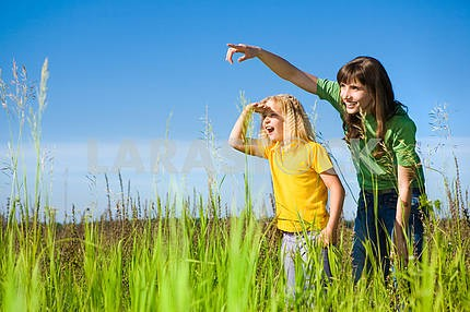 Happy Mother and Daughter on Field. Girl Surprised Something.