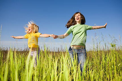 Happy mother and daughter at field