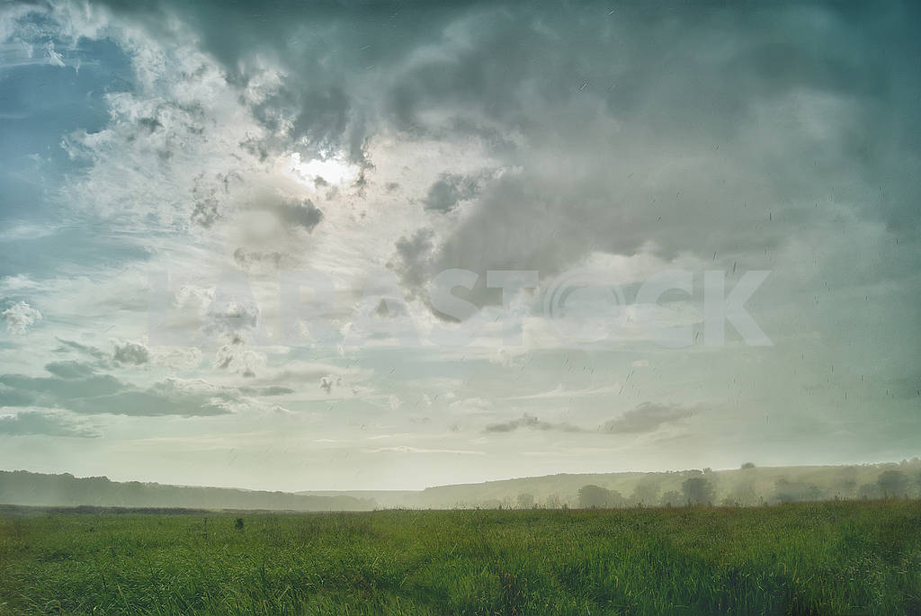 Torrential rain and sun in a valley against a backdrop of hills — Image 57089