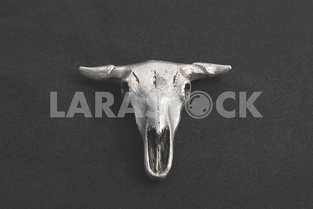 Pendant in the form of a bull's skull on a black background — Image 57119