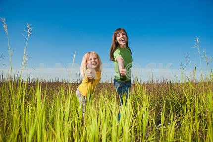 Happy mother and daughter on field