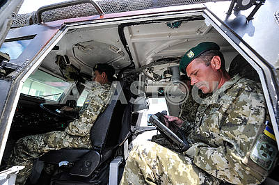 Border guards in an armored personnel carrier