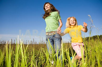 Happy woman and girl making exercises on field