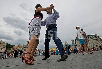 Young couple dancing waltz