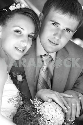 Portrait smiling groom and bride