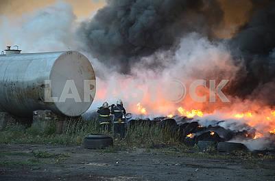 Firefighters extinguish tires