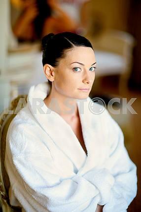 Beautiful girl in a white coat