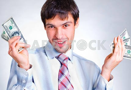 businessman holds money in a hands