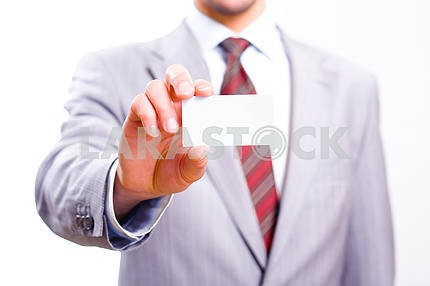 A studio shot of a businessman holding out a blank business card