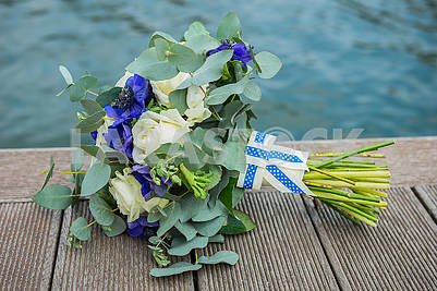Wedding bouquet violet and white near the river - flat lay