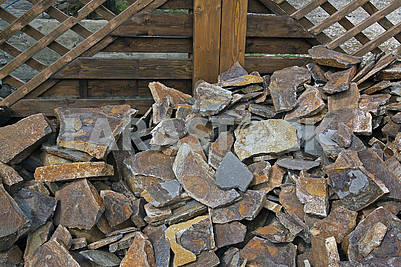 Sandstone on the background of a wooden construction