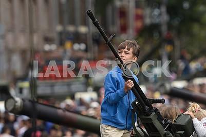 Boy with a machine gun
