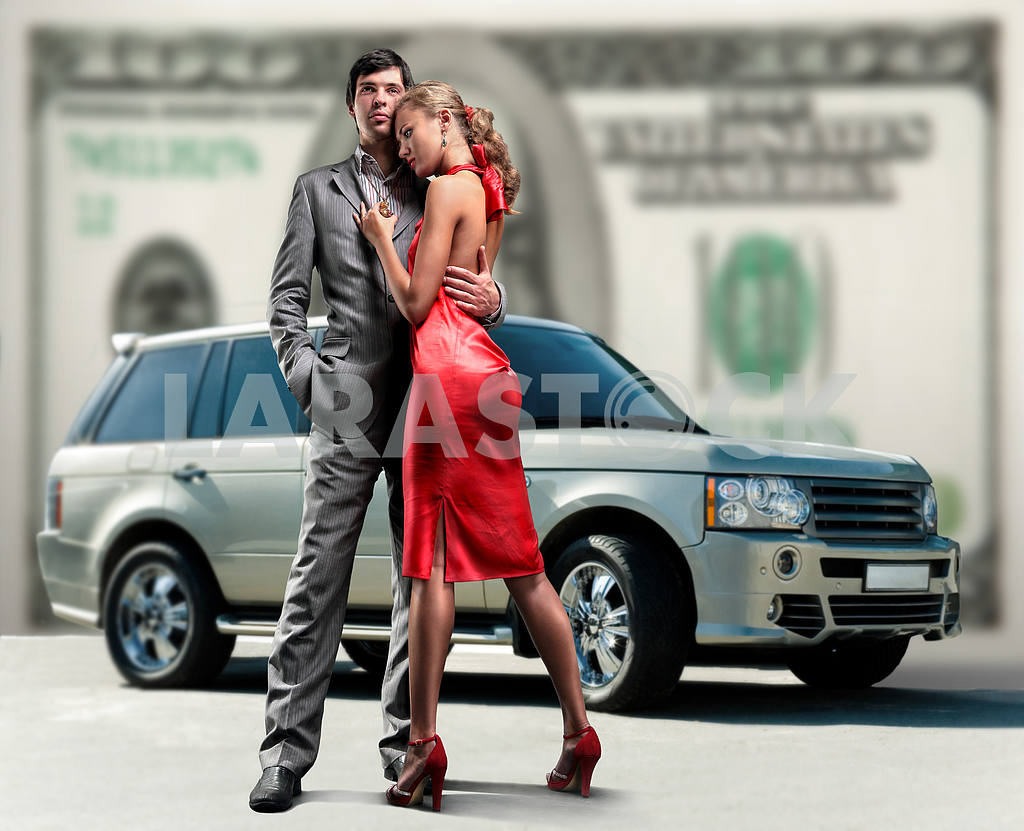 Young beautiful couple backdrop car, money. — Image 6180
