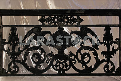 Window with decorative railing from black smithery iron