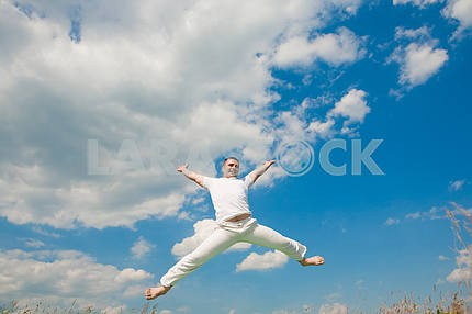 Happy young man - jumping