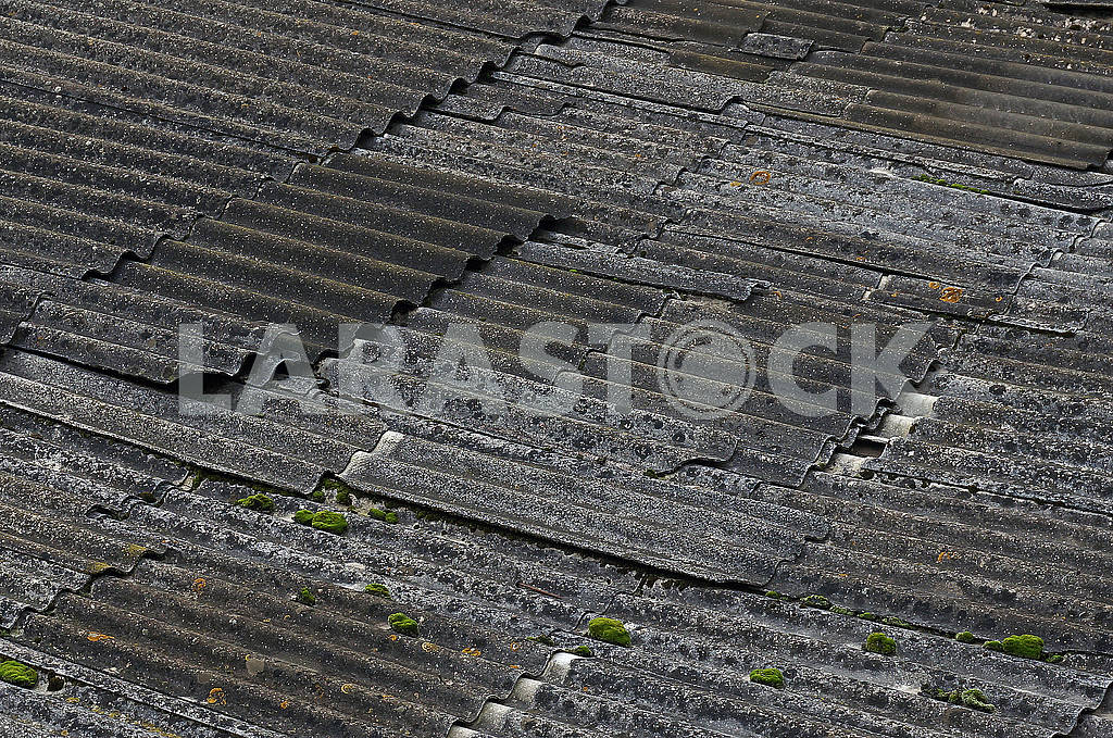The destroyed asbestos roof in the dark weather — Image 63239