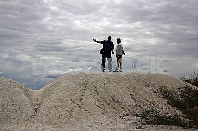 Two photographers are standing on a hill of the cretaceous plate