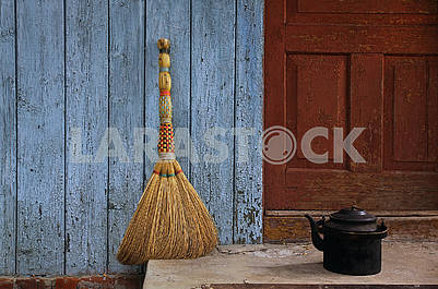 Broom and old teapot