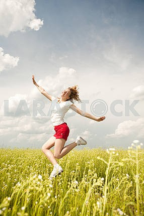 Happy young women running in field