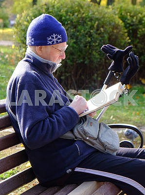 The man is reading a book