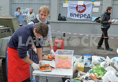 The rally participants prepare food
