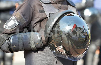 Reflection in the helmet of a policeman