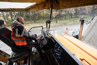 Asphalt paver driver
