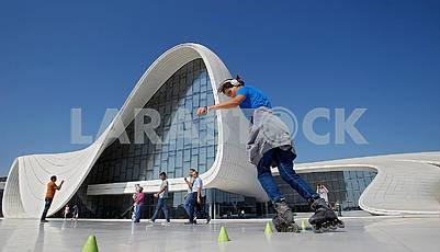 Girl on roller skates. Heydar Aliyev Center